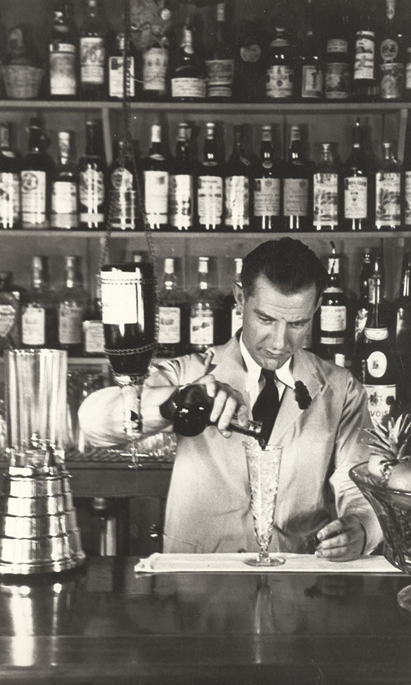 Black and White Image of cocktail being poured in Trader Vic's. About London.
